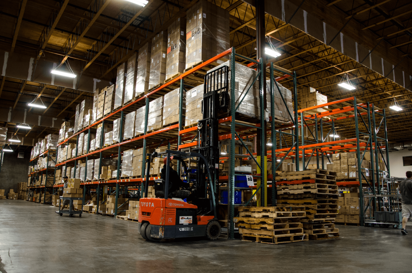 person using stacker in warehouse
